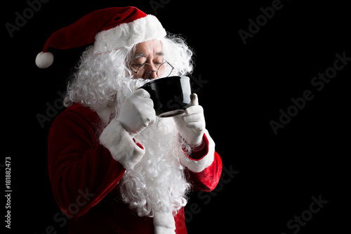 Papiers peints Cafe Portrait of Santa Claus holding a cup isolated on White Background