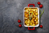 Baked potatoes with spices and rosemary, top view - 181883449