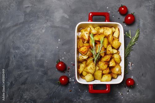 Fototapeta Baked potatoes with spices and rosemary, top view