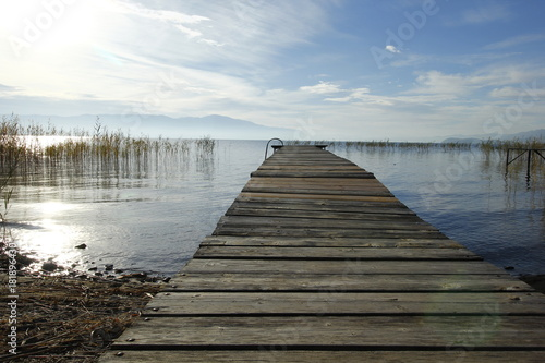 Aluminium Pier Old wooden pier by the Ohrid Lake with a cloudy sky on an autumn day