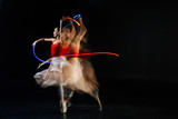 Gracious movements. Professional elegant female dancer moving her hands and dancing while performing on stage - 181906248
