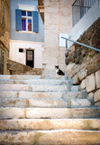 Typical narrow street with stairs in Ermoupoli town, on Syros island in Cyclades,Greece - 181921878