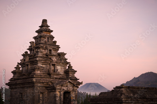 Aluminium Boeddha Sunset view of Dieng plateau with ancient stone hindu temple and volcano, in Java, Indonesia.