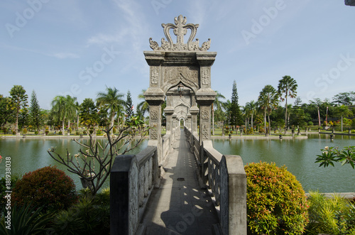 In de dag Bali Sculpted stone bridge over artificial pond in Ujun Palace gardens, in Bali, Indonesia.