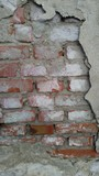 red brick wall under broken plaster background