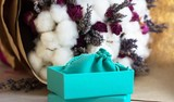 Turquoise box for present on flower background - 181948062