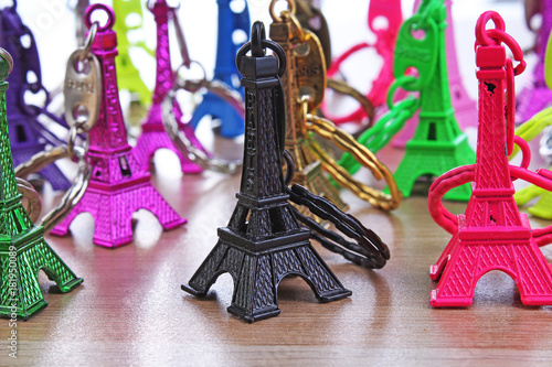 Wall mural Eiffel tower statue. Paris tourism illustration. Beautiful metallic plastic souvenir statue. Colorful illustration of french tourism or any other concept. Eiffel tower colorful and black grief
