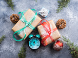 Christmas new year wrapped gifts with ribbons and snow flakes. Almost midnight on the clock - 181952495