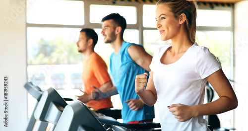 Sticker Picture of people running on treadmill in gym