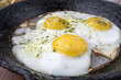 appetizing fried eggs in an old frying pan - 181976485
