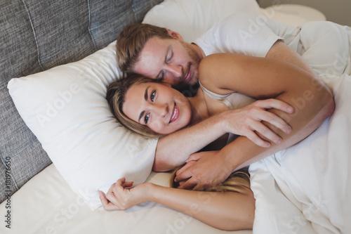 Plagát Romantic couple bonding in bed
