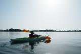 Boy in life jacket on green kayak - 181978463