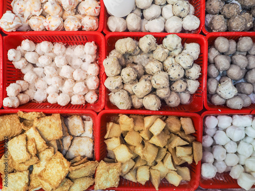 Siu mai, stinky tofu and fish balls in small containers sold at