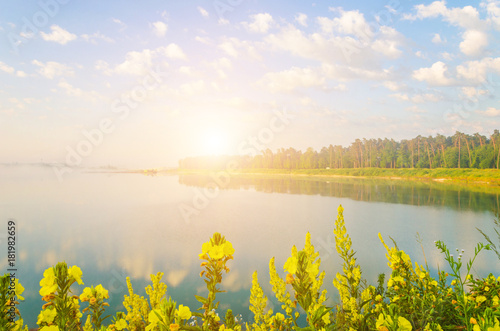 Foto op Plexiglas Wit Blue and orange sky from sunset on the lake.