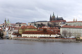 View on the autumn Prague gothic Castle above River Vltava, Czech Republic - 181984013
