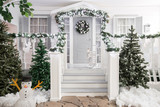 house entrance decorated for holidays. Christmas decoration. garland of fir tree branches and lights on the railing - 181987219