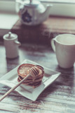 Delicious breakfast. Homemade Pancakes with honey and cup of tea on wooden rustic background table. Vintage style retro toned image - 182014615