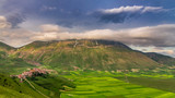 Sunset in the mountains over Castelluccio, Italy