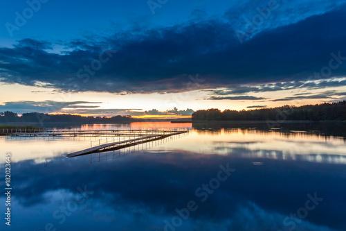 Fotobehang Zomer Wonderful blue sunset at the lake in summer