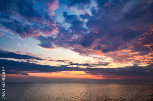 Tuinposter Zee zonsondergang Calm sea and beautiful sunset in summer