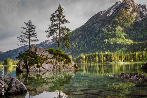 Foto op Canvas Natuur Foggy sunrise at Hintersee lake in Alps in summer