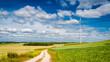 Wind turbines on green field as alternative energy in summer
