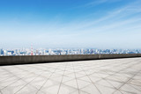 empty marble floor with modern cityscape