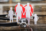 Close-up Of Family Cut Out And Red Heart - 182030887