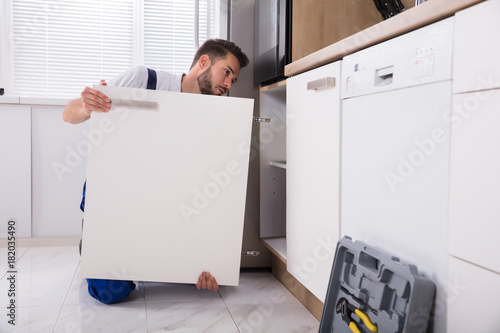 Handyman Fixing Sink Door