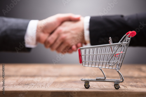 Close-up Of Shopping Cart On Wooden Table