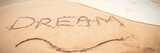 Inscription dream on sand - 182045247