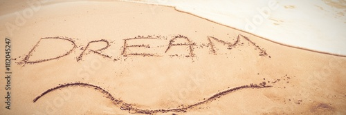 Inscription dream on sand