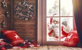 Santa Claus is knocking at window