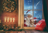 Santa Claus is knocking at window - 182051095