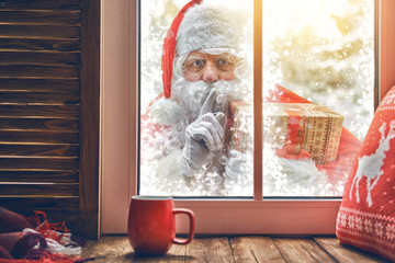 Santa Claus is knocking at window