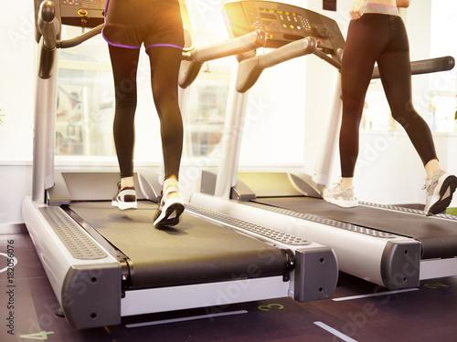 Tuinposter Jogging women running on treadmill