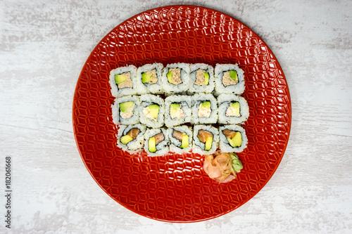 Plexiglas Sushi bar Japanese food Sushi Roll Maki of Salmon and avocado
