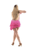Rear view of graceful elegant professional blonde latino dancer moving slowly. Full body length portrait isolated on white studio background.  - 182070233