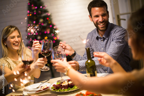 Young people celebrating New Year and drinking red wine - 182075064