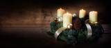 Advent wreath with four white burning candles and christmas decoration on rustic dark wood, panorama format with copy space - 182080635