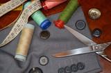 Taglio cucito bottoni cotone - 182087601