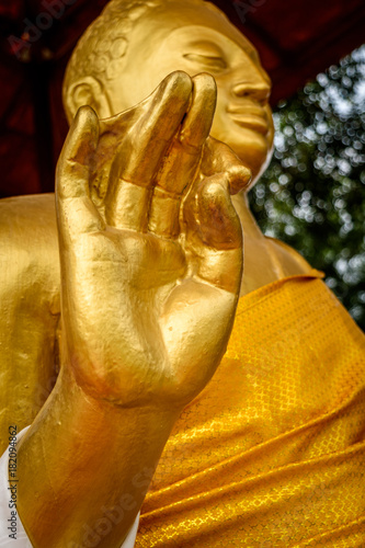 Fotobehang Boeddha Statue of Lord Buddha with selective focus at wat thai Buddhist monastery.