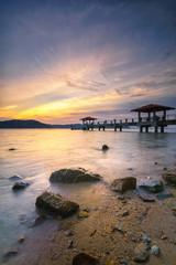 Panoramic view of dramatic golden hour at Batu Musang jetty, Penang
