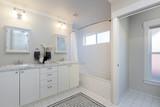 Modern Bathroom with double sink and bath tub. - 182124653