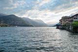 Como lake, Como city, northern Italy. View of Lake Como by the end of the lakefront promenade of Como town. In the background the stretch between the towns of Cernobbio and Laglio and the Alps - 182127299