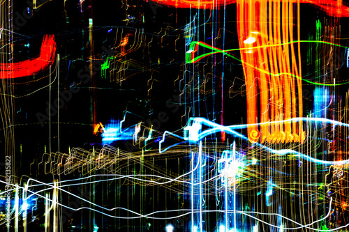 Foto op Canvas UFO Abstract of multicolored city lights beams in motion, Moving colorful lines or light painting LED building abstraction on busy city Light trails, Rainbow and chaos black background. Vertical desigh