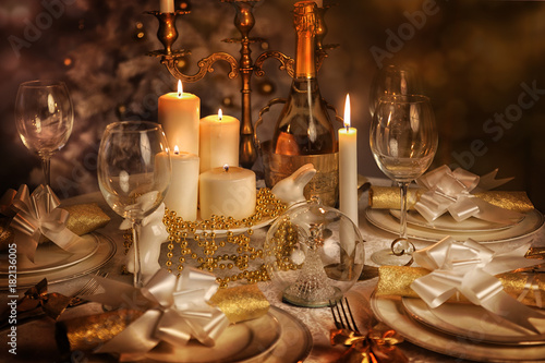 Festive dining table with lighted candles Poster
