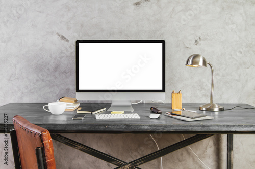 Table with empty white computer screen front