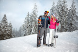 Couple in love on skiing for winter holiday