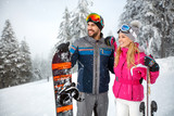 Male and female on skiing for winter holiday